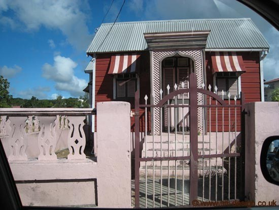 Barbados chattel house in all shades of pink. Photo by Colette van den Thillart